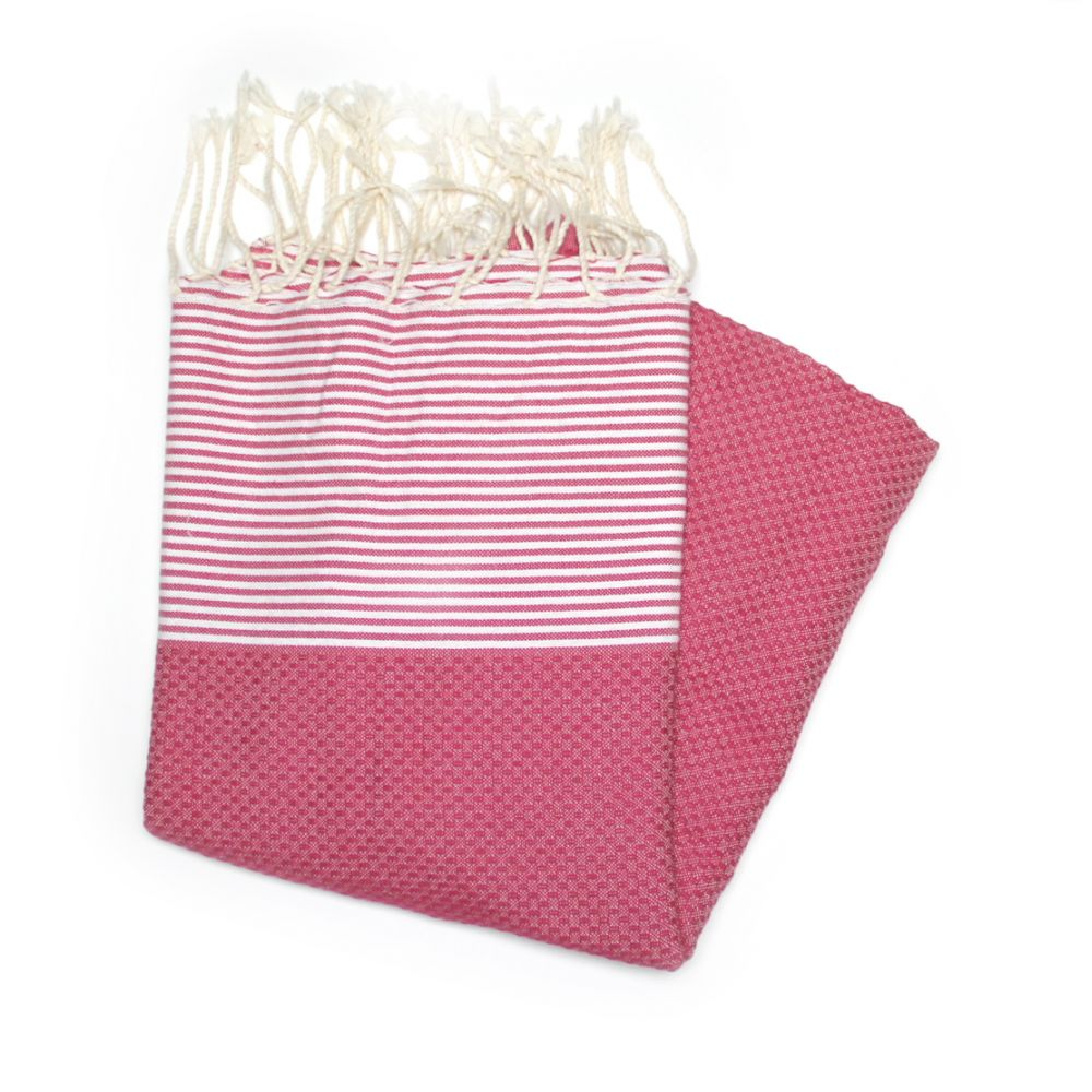 This Is Our Zanzibar Rasberry Hammam Towel Which Has A Honeycombed Texture Mainly A Dark Pink Colour With White Stripes At Each End.