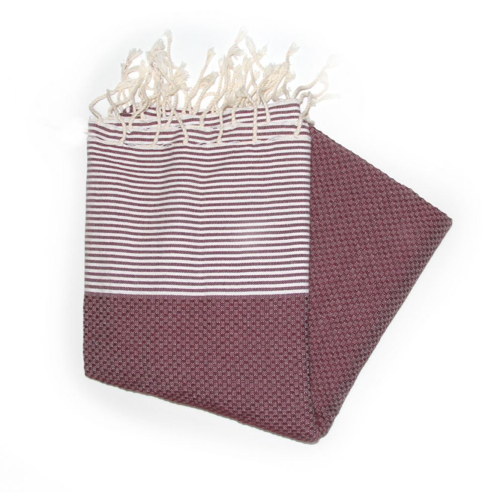 This Is Our Zanzibar Burgundy Hammam Towel Which Has A Honeycombed Texture Mainly A Dark Red Colour With White Stripes At Each End.