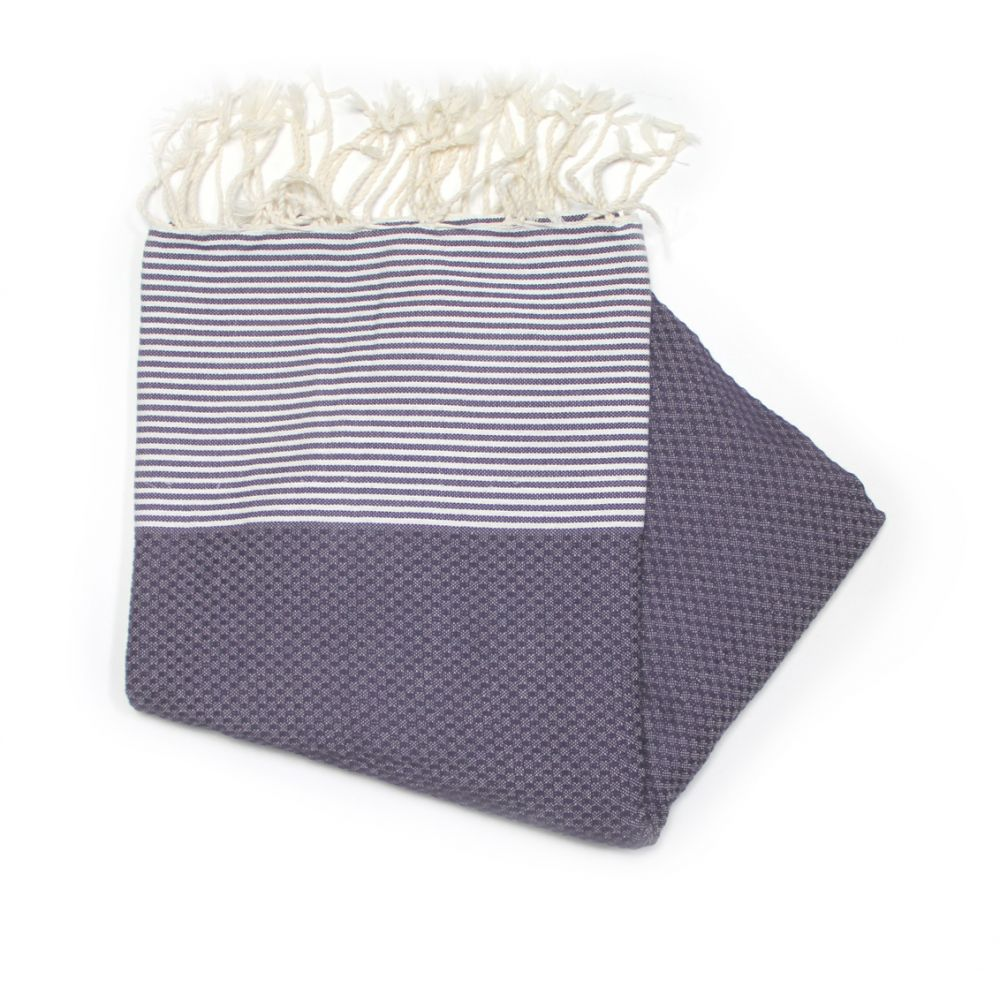 This Is Our Zanzibar Lavender Hammam Towel Which Has A Honeycombed Texture Mainly A Dark Purple Colour With White Stripes At Each End.
